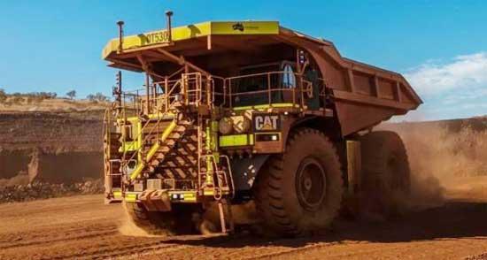 CAT? (卡特)无人驾驶矿用卡车运输?#30475;?0亿吨