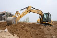 卡特彼勒M315D2轮式挖掘机施工现场30889