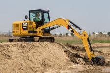 卡特彼勒305.5E2小型挖掘机施工现场35858