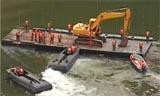 堰塞湖排险工作进行中 工程机械运抵堰塞体