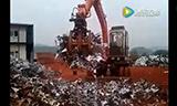 晋工轮挖JGM9085L 堆、运废弃金属碎屑,高效安全