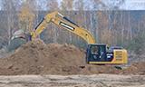 卡特323F挖掘机工作