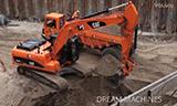 卡特324D挖掘机装载卡特D25D自卸车
