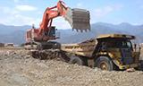 日立EX1200挖掘机装载卡特777卡车