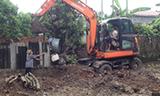 斗山轮式挖掘机用竹子打桩