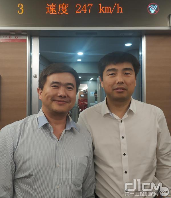 黄培博士与张启亮先生的合影