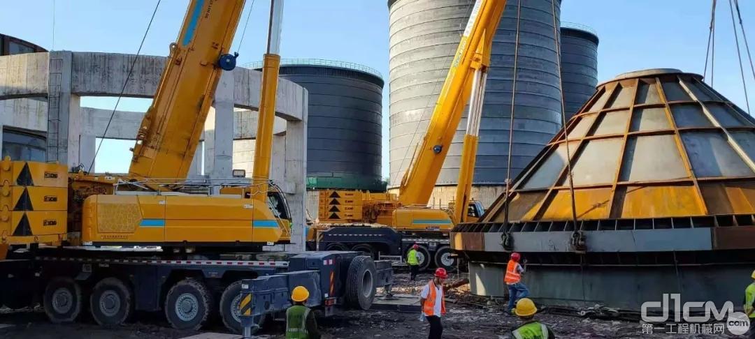 重庆万州的九龙万博特铝新材料项目施工现场,两台徐工超级起重机严阵以待