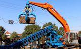 油电两用 挖掘机也开始走向环保的征程